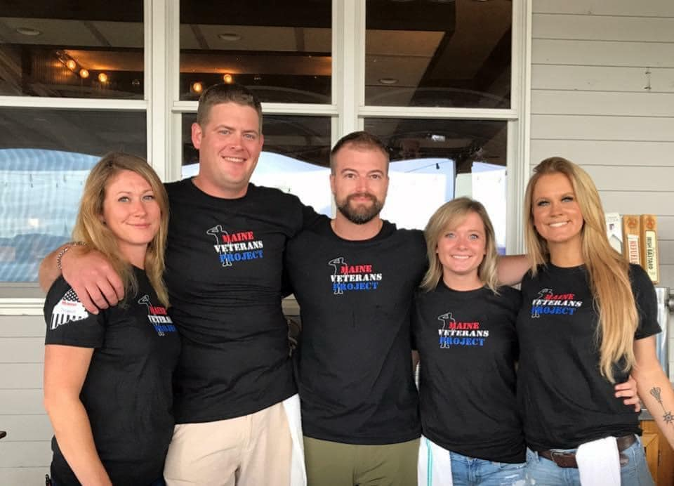 photo of five people wearing black maine veterans project teeshirts