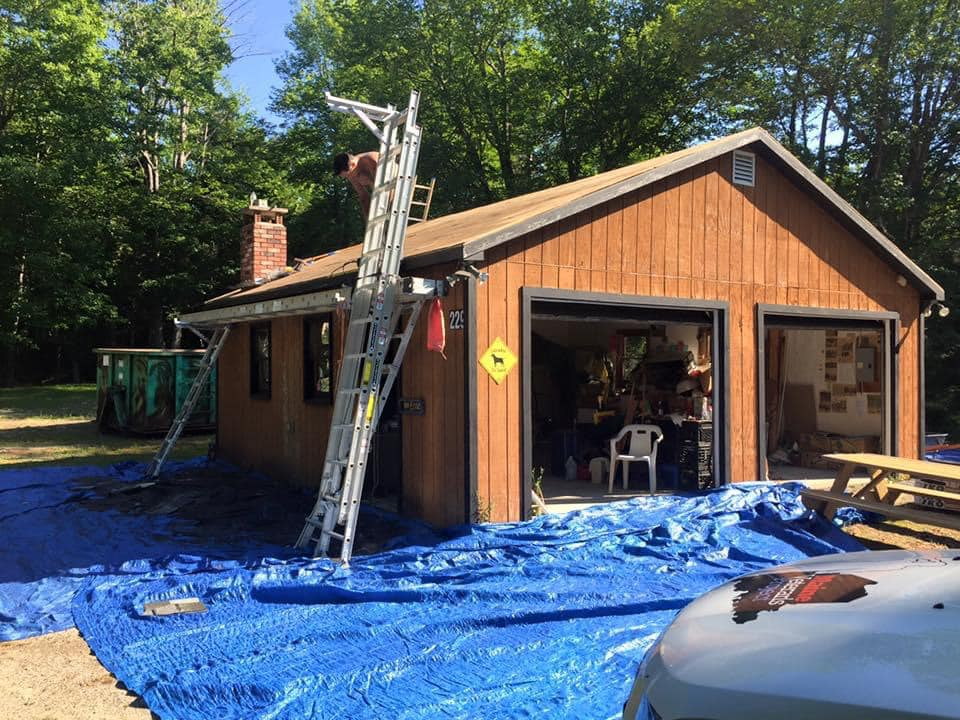 photo of man repairing garage roof