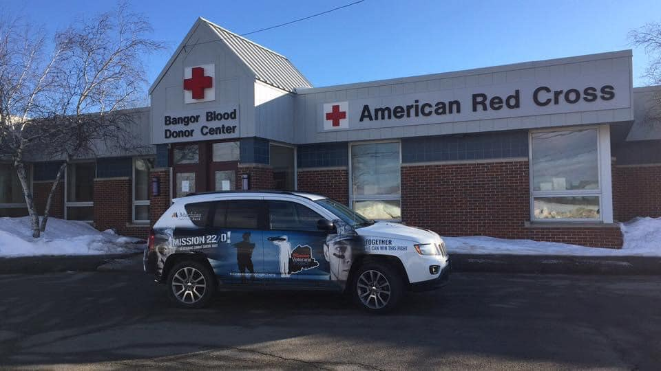 photo of maine veterans project vehicle parked in front of american red cross bangor blood donor center
