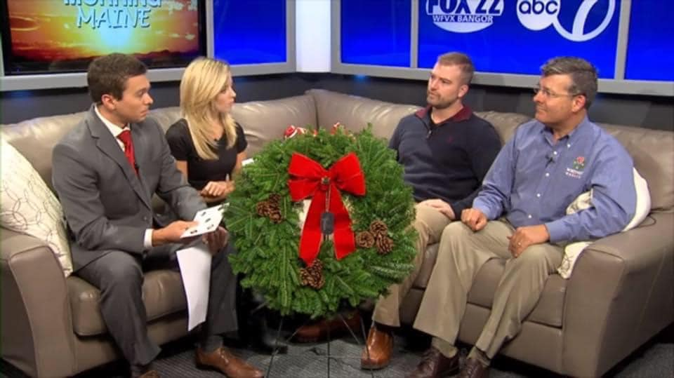 photo of four people speaking on a sectional couch for good morning maine early morning news program with christmas wreath
